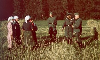 Himmler and his entourage with local peasants in Belarus while touring the operation zones of the.jpg