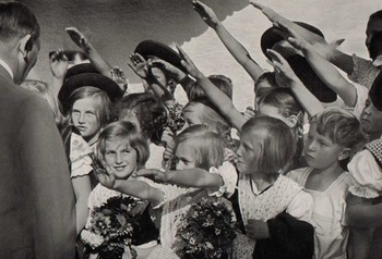 Hitler_with_a_group_of_young_girls_saluting_him.jpg