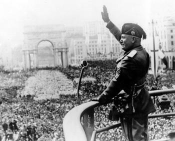 Italian dictactor Benito Mussolini saluting during a public address.jpg