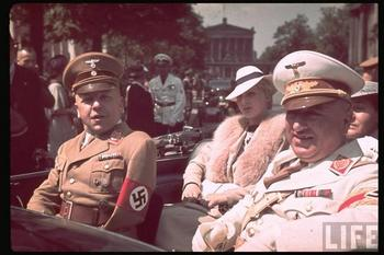Nazi leaders Max Amann (Reich Press Chamber) and Robert Ley (German Labour Front) in Berlin, June 1939. The attractive lady in the back seat is Frau Ley.jpg