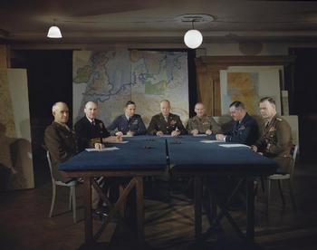 Omar Bradley, Bertram Ramsay, Arthur Tedder, Dwight Eisenhower, Bernard Montgomery, Trafford Leigh-Mallory, and Walter Bedell Smith meeting in England.jpg