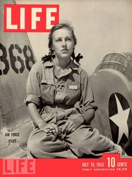 Pilot trainee Shirley Slade she sits on the wing of her Army trainer at Avenger Field, Sweetwater, Texas, July 19, 1943..jpg