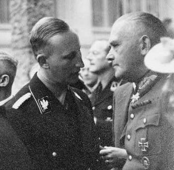 Reinhard Heydrich and Werner von Blomberg at party.jpg