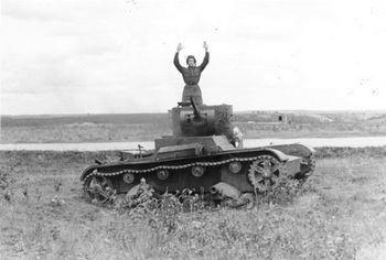 Russian tank soldier in light tank T-26 B surrenders.jpg