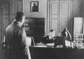 SS General Reinhard Heydrich in his office during his tenure as Bavarian police chief. Munich, Germany, April 11, 1934.jpg