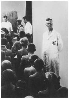 SS doctors examine Polish children judged racially valuable for adoption by Germans. Poland, October 1942..jpg
