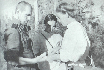 Soviet nurses treating the wound of a captured german SS.jpg