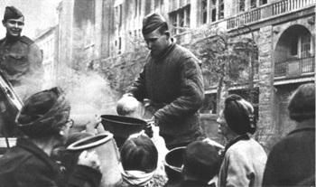 Soviet soldiers distributing hot food to Berlin women, 1945.jpg