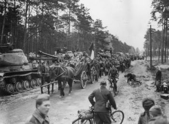 Soviet tanks IS-2 and the column of the liberated French soldiers.jpg