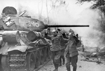 T-34 of 3rd Soviet tank army in Berlin and German captives.jpg