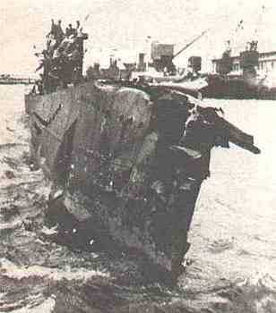 The heavily damaged U-333 returns to base.jpg