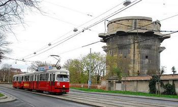Tram in front of the Flakturm VII - G-turm.wine.jpg