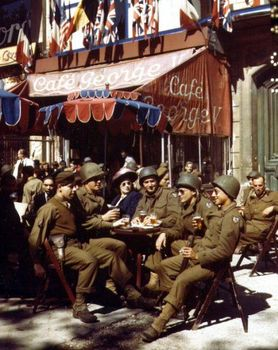U.S. soldiers in liberated Paris at a sidewalk table at the Cafe George V.jpg