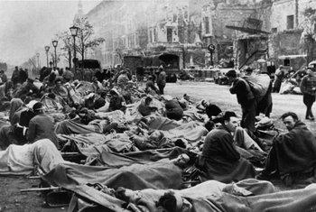 Wounded German soldiers line Unter den Linden.jpg